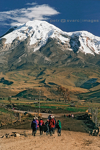 Indigenous People Walk along Road near Chimborazo, Ecuador